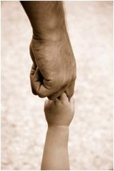 Parent's hand holding child's hand
